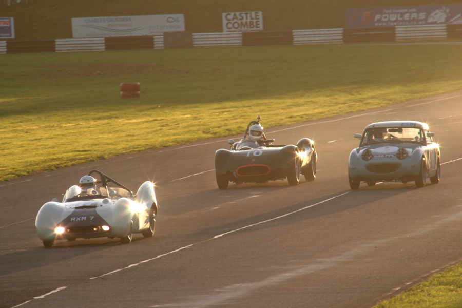 With the sun ever lower in the sky, the leaders lap John Tewson in the Frogeye Sprite