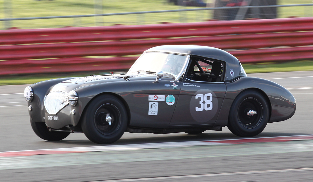 One of the heroes from last year's Castle Combe race! Mike Thorne presses on in his Austin Healey 100M  Photo - Richard Styles