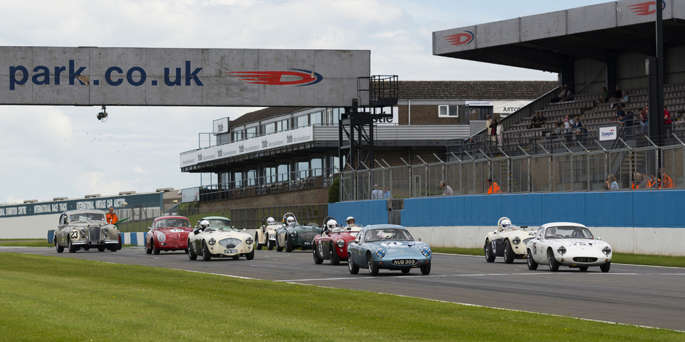 Startline. The grid dwarfed by Graham Love's Jaguar Mk VII.           Photo - Rich Corbin
