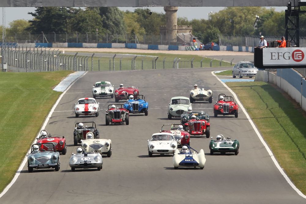 Getting off the line provided a rapid reshuffle with Hardy (Austin Healey - extreme left) making a superb start and Brian Arculus (Lotus IX) also coming through from the second row.             Photo - Mick Walker