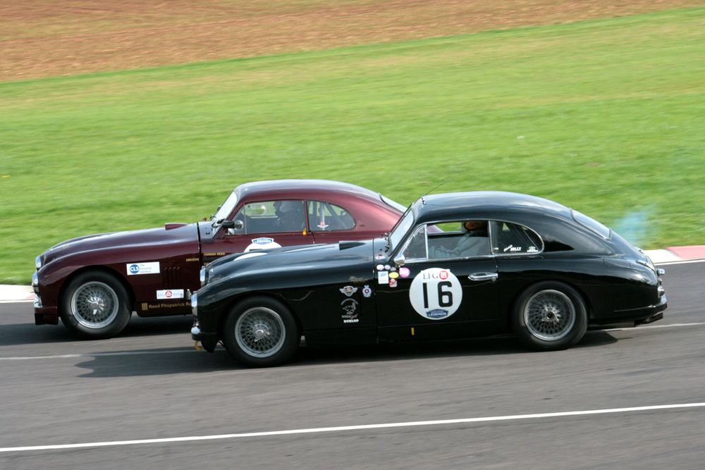 Split eventually by Paul De Havilland in his Jaguar XK150, the DB2s of David Reed and Chris Jolly were involved in a titanic struggle for 2nd place in the Jon Gross Memorial Trophy.        Photo - John Turner