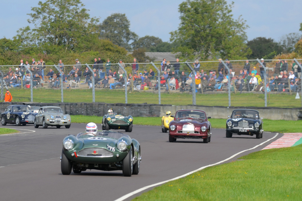First lap and Simon Hadfield has already established a gap, whilst Steve Boultbee-Brooks has dropped to 5th behind David Reed, Chris Jolly and Steve McCulloch. Note the XK150 of Paul De Havilland in the background who featured heavily in the battle for second, and just coming into shot, Nick Ruddell in his DB2/4 Mk1,              Photo - Ollie Read