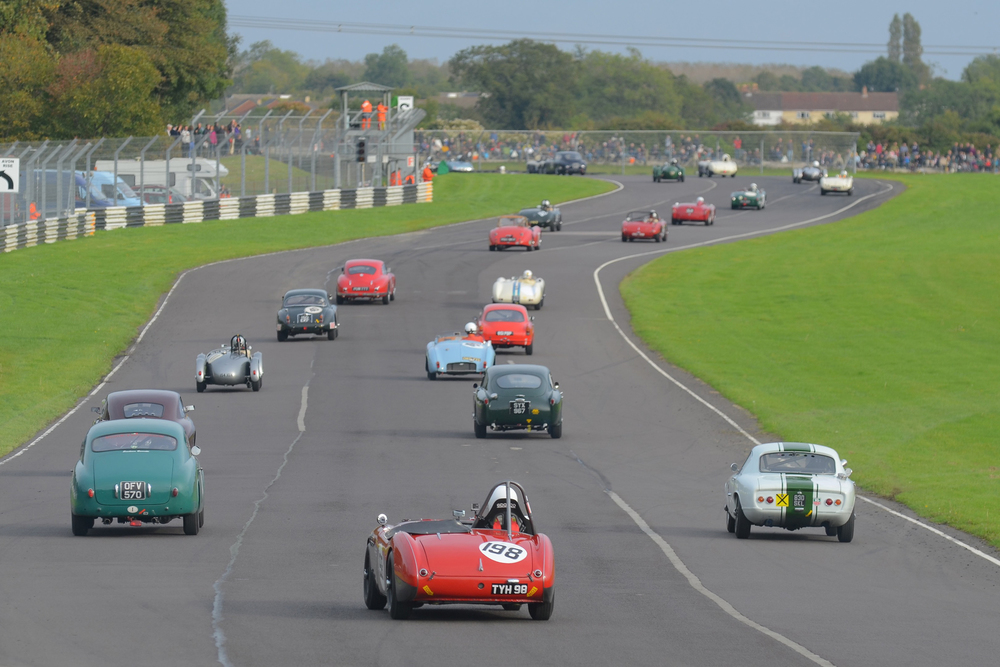 The Austin Healey 100/4 of Nick Matthews (no qualifying time recorded!) is tail gunner to this big field.as they head out on the formation lap.  How many marques and models can you identify?               Photo - Ollie Read