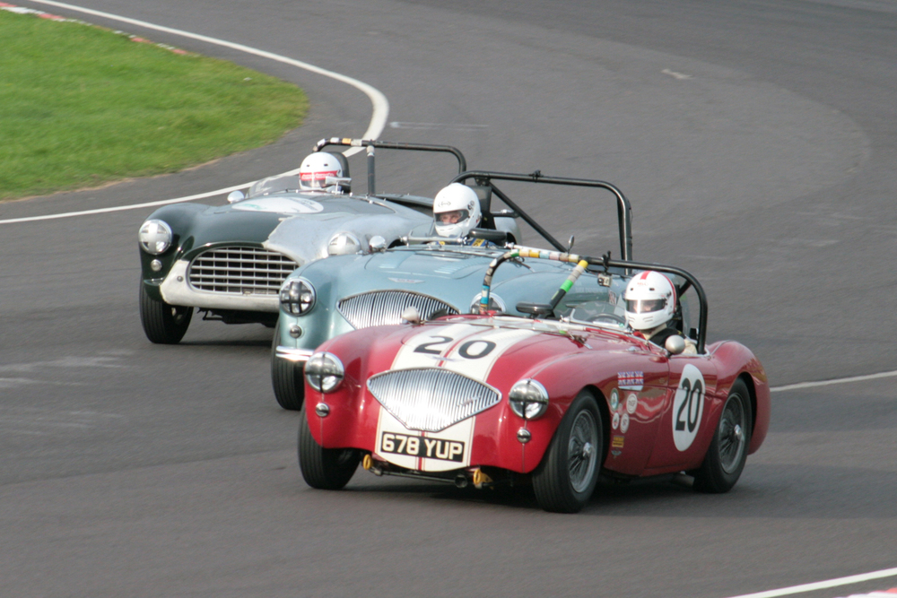 Close racing! The Jonathan Abecassis Austin Healey, the Neil Hardy/Nils-Fredrik Nyblaues Austin Healey and the Murray Shepherd AC Ace Bristol.                                                       Photo - John Turner