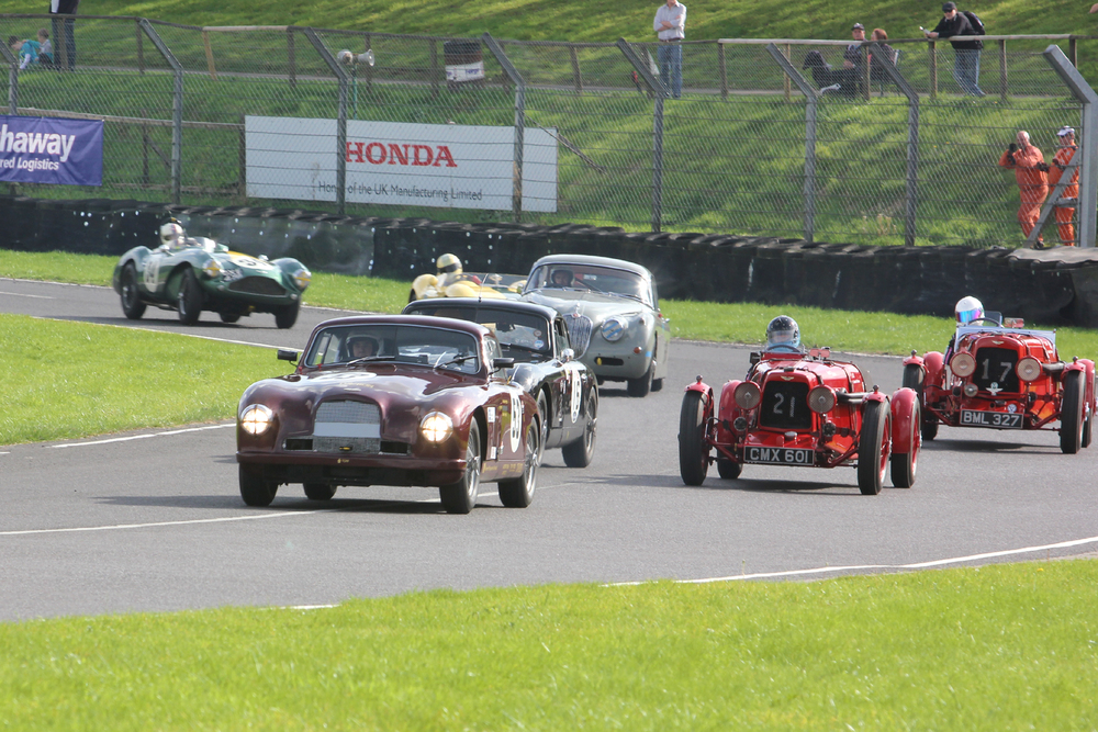 Annette Mason and Holly Mason-Franchitti stay wide as the 5 car battle for 2nd place comes steaming through Tower Corner in the order Reed, Jolly, De Havilland, McCulloch and Boultbee-Brooks.            Photo - Pat Arculus.