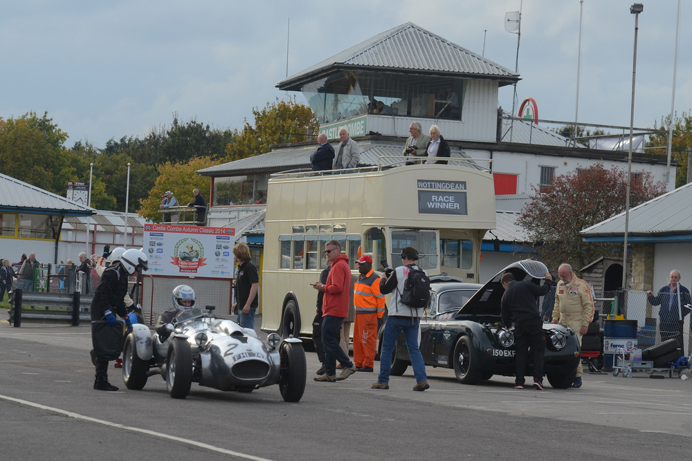 Race sponsor, Peter Campbell (of Spencer- Lane Jones) stands by his Wingfield Bristol Special which has just been taken over by Andrew Mitchell. To the right, the sad sight of the raised bonnet of the XK150 presages the retirement of Claire Keith-Lucas from the race. In the background the wonderful old Bristol open topper used to take the winners on their victory lap. Photo - Ollie Read