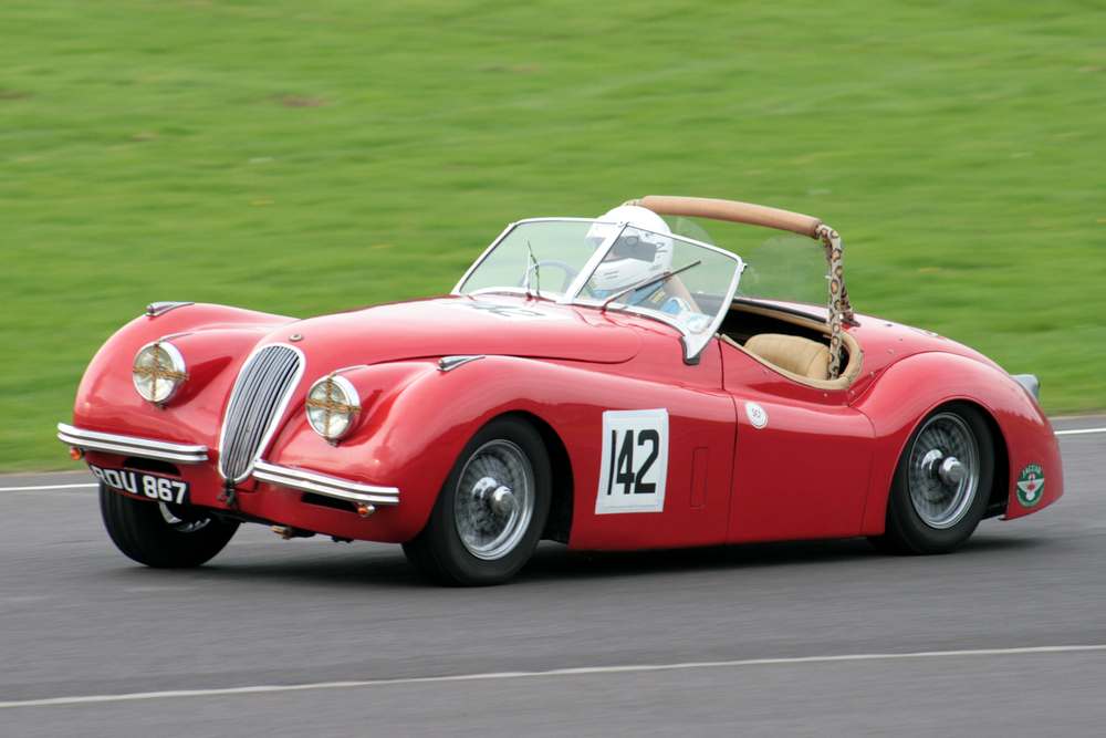 Geoff Ottley displays the XK120's droopy rear end!                                                        Photo - John Turner