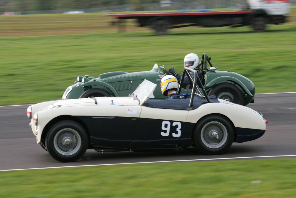 Richard Woolmer, driving Matthew Collings Austin Healey 100M, glances across at Martin Hunt, in the Frazer Nash Le Mans Replica and gets the thumbs up. They finished 14th and 12th respectively.                       Photo John Turner