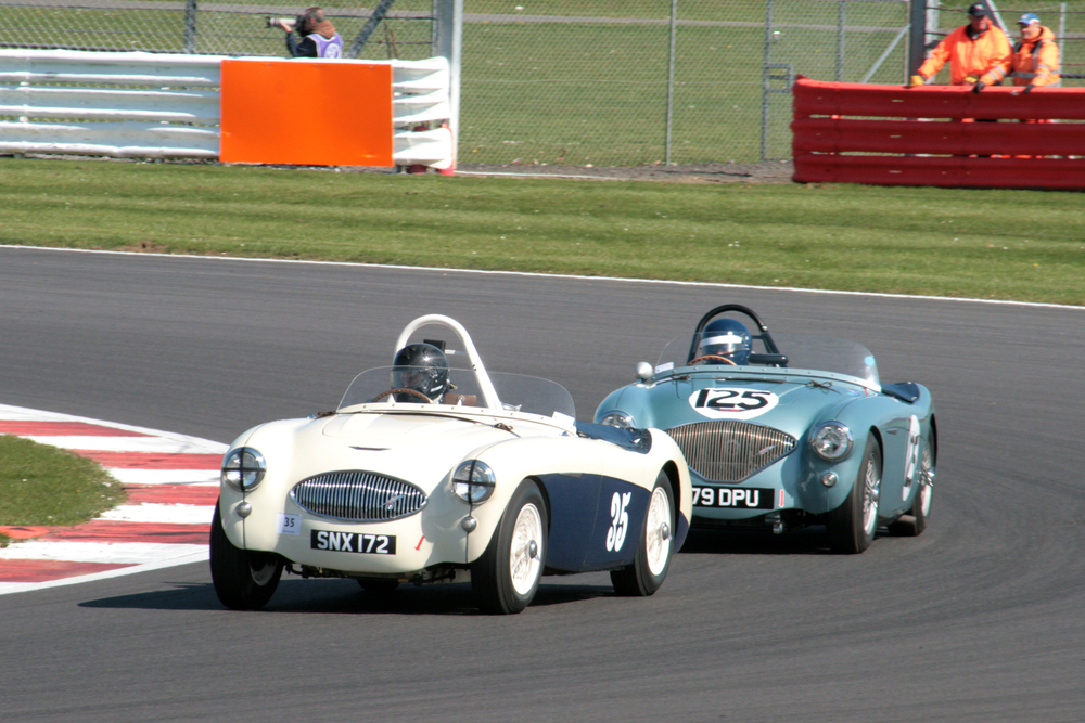 Paul Griffin (Austin Healey 100S) leads Robert Clarke (Austin Healey 100/4) Note the radiator grill is the obvious difference although the 100M shares the same grill as the 100/4 which makes visual identification almost impossible.   Photo - John  Turner