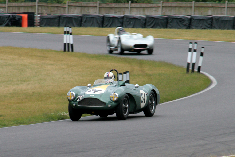 Steve Boultbee Brooks had the Inter-Marque race under control in his Aston Martin DB3s, over the chasing Stephen Bond in the Lister Bristol until the Aston slowed dramatically on the last lap and died completely in sight of the chequered flag as Bond swept by to win. However, in an action recalling an earlier heroic age of motor racing, Steve then pushed the Aston  up the Senna Straight to finish 3rd, an action that earned for him the Motorsport News Spirit of the Day award.  As a result of the Aston's last minute drama, Stephen Bond and Adam Singer (Kurtis 500s) won the team award as the 'Newcomers' team from 'The Italian Job'  team of Chis Mann (Alfa Romeo Disco Volante) and Grahame Oakins (Alfa Guilia Sprint and 'The Lightweights' team comprising Jonathan Smare (Lotus Elite) and Mandie Hadfield (Elva Courier)       photo - John Turner