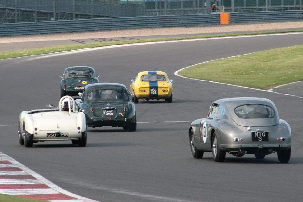 FISCAR at its best 5 marques - MG, Lotus, Jaguar, Austin Healey and Aston Martin in close formation              Photo - John Turner