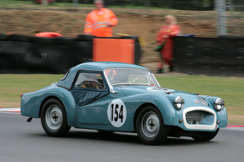Great newcomer. First time out with his restored Triumph TR2 was Paul Ziller. Here he adds a touch of opposite lock exiting Druids. He was classified 7th of the FISCAR cars in the race.                                                               Photo - John  Turner