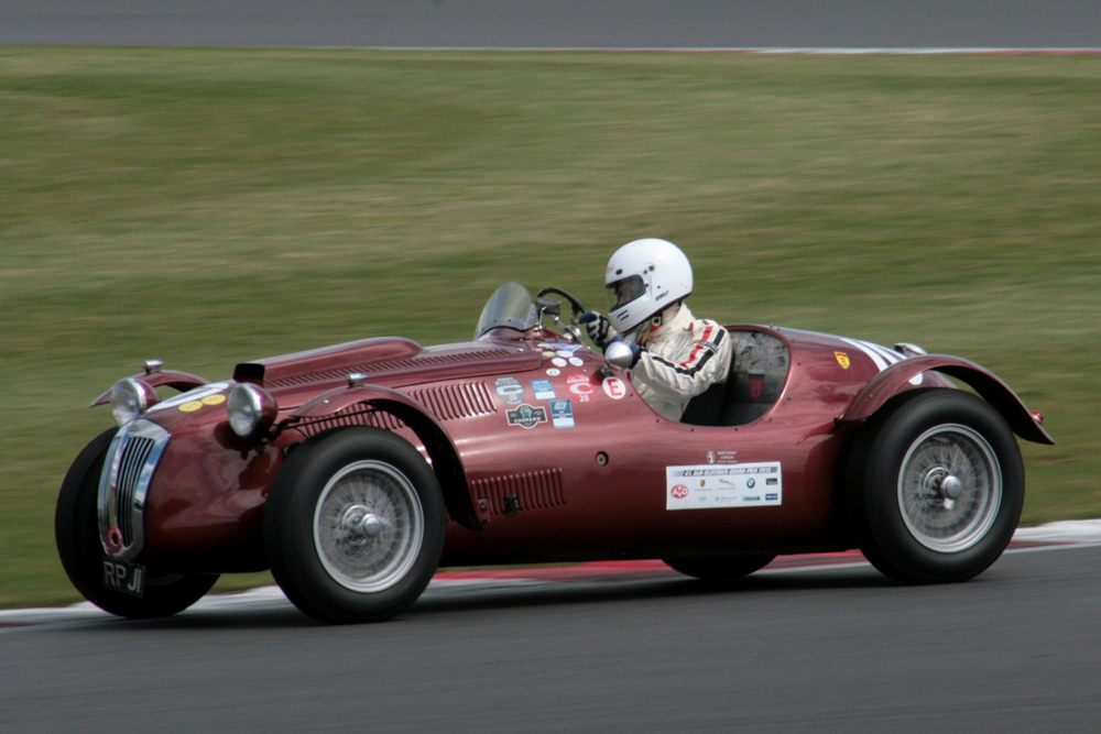 John Ure in Peter Mann's Frazer Nash Le Mans Replica improved substantially on his qualifying position  Photo - John Turner