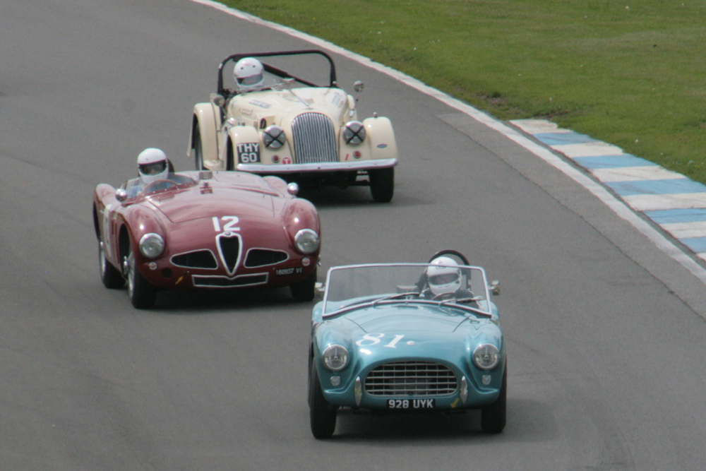 David Cottingham (AC Ace), Christopher Mann (Alfa Romeo Disco Volante) & Richard Thorne (Morgan +4) at the bottom of the Craner Curves about to turn into the Old Hairpin on the first lap.                                                       Photo - John Turner