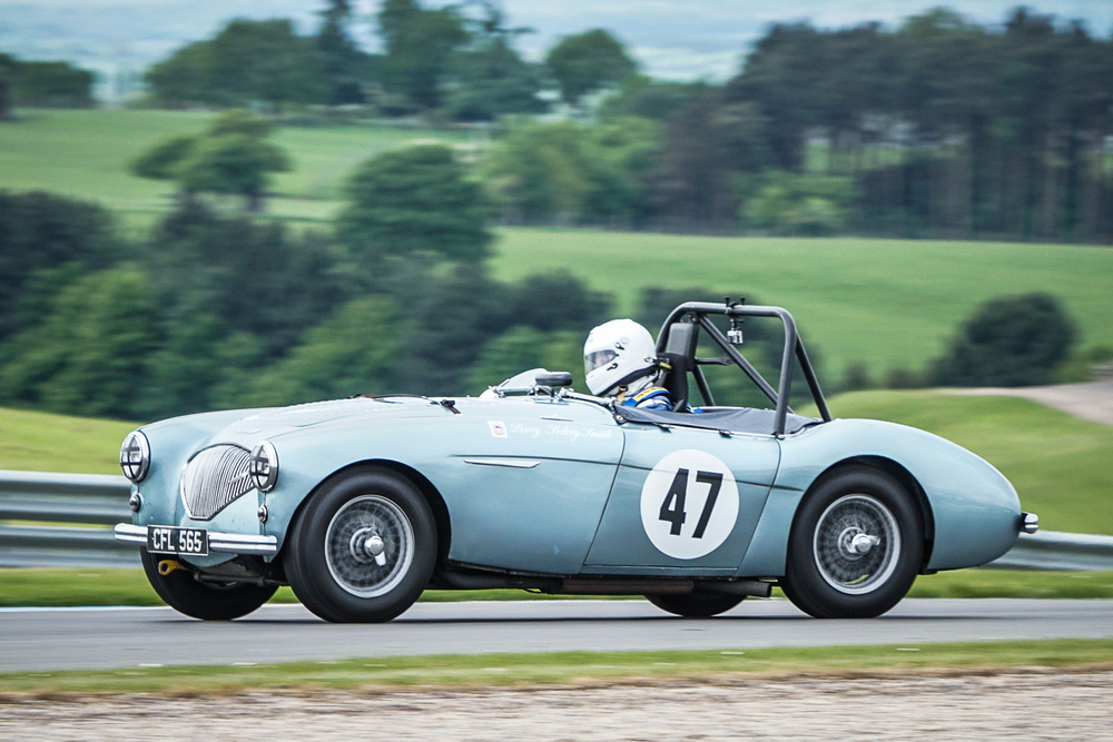 A game chase by Neil Hardy netted him 2nd in his Austin Healey                                            Photo - Chris Dicken, Tripos Media