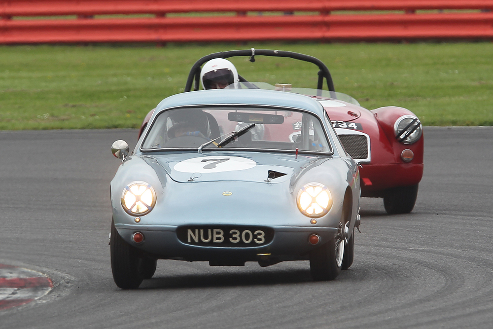 Brian Arculus starts his charge through the field having just passed Terry Bryant in the MGA. It was Terry's first race outing for 3 years. Photo - Mick Walker