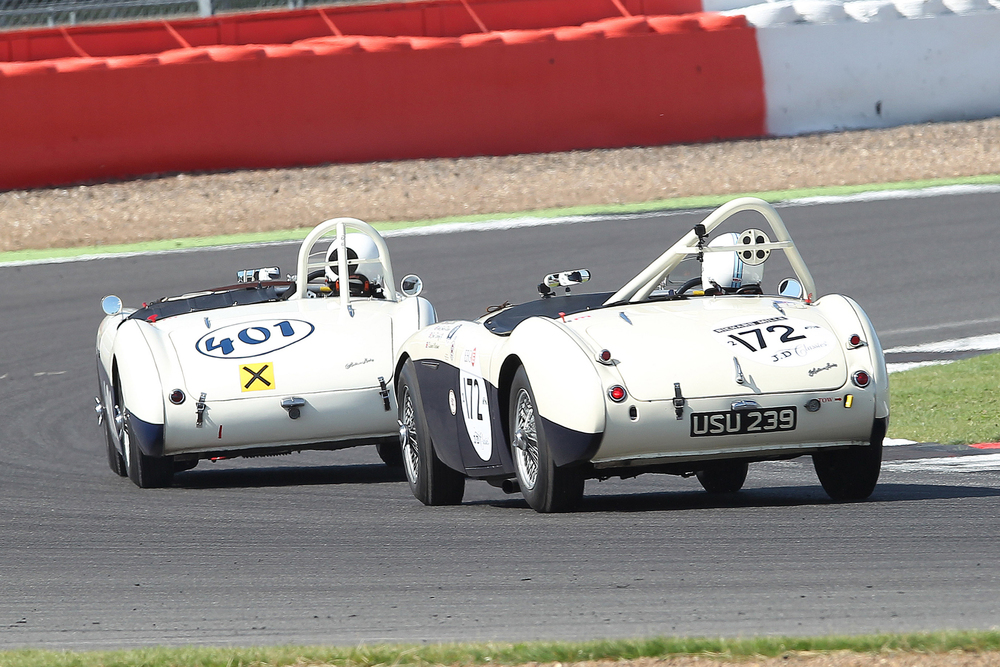 Jason Harris (Austin Healey 100/4) leads Graham Robson (Austin Healey 100M) in their great dice.           Photo - Mick Walker