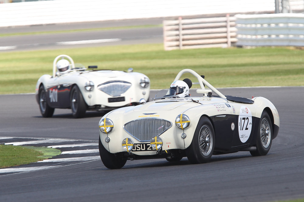 Graham Robson's Austin Healey 100M chose to eat rubber rather than burn it!  Just ahead out of shot is Jim Campbell's 100/4 and just behind (401) Jason Harris's similar model.                                                                              Photo - Mick Walker