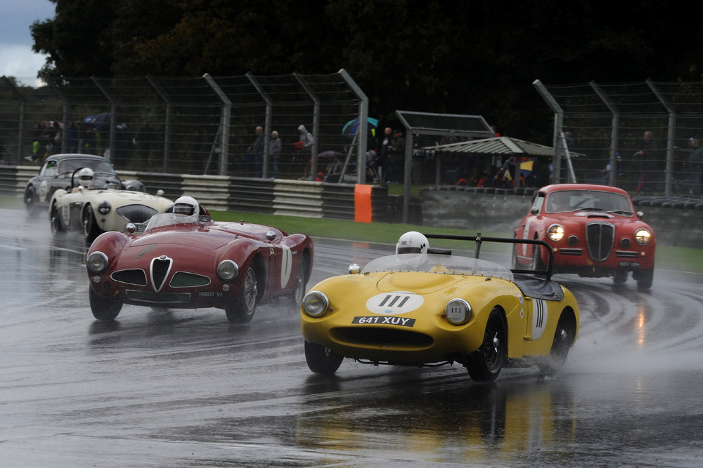 Probably the best first lap of all was that of Rob Cobden in the little Fairthorpe Electron making 13 places. Italian classics behind him are Chris Mann's Alfa Romeo Disco Volante, and Jason Kennedy, keeping rather drier in the Lancia Aurelia B20GT.       Photo - Jeff Bloxham