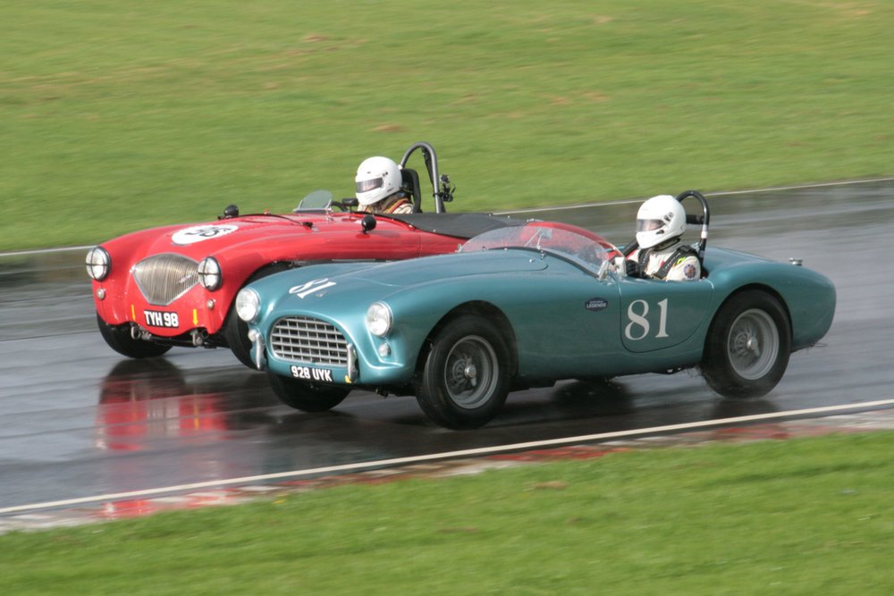 Classic 50s sports cars. Nick Matthews laps David Cottingham in his AC Ace Bristol                Photo - John Turner
