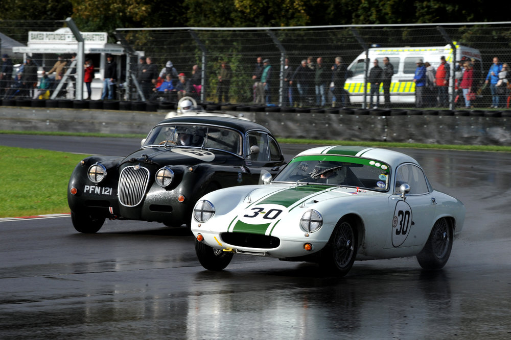 Barry Dye in his Lotus Elite about to be lapped by Graham Love in his Jaguar XK150                        Photo - Jeff Bloxham