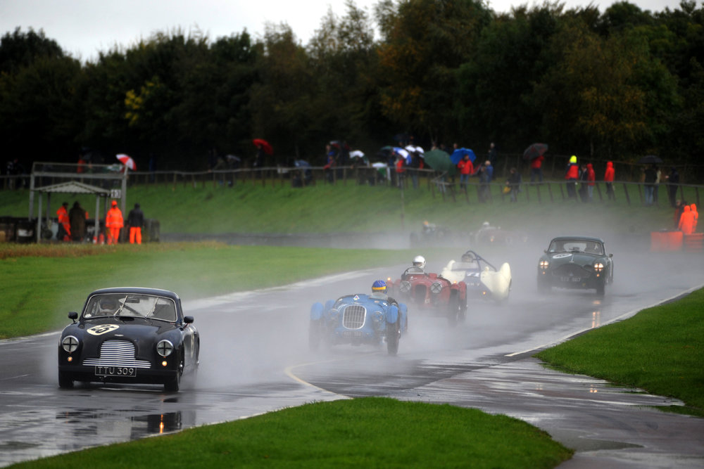 But behind Steve, a delightful group of cars crossed the line for the first time _ Nick Ruddell (DB2/4), Sam Stretton (Alta Sports), Mark Gillies (Aston Monoposto), Brian Arculus (Lotus IX) and Chris Woodgate (DB MkIII). Barely visible is Chris Mann, according to the lap charts aleady 6 seconds behind being pushed hard by Simon Diffey in the Aston Ulster.                                         Photo - Jeff Bloxham
