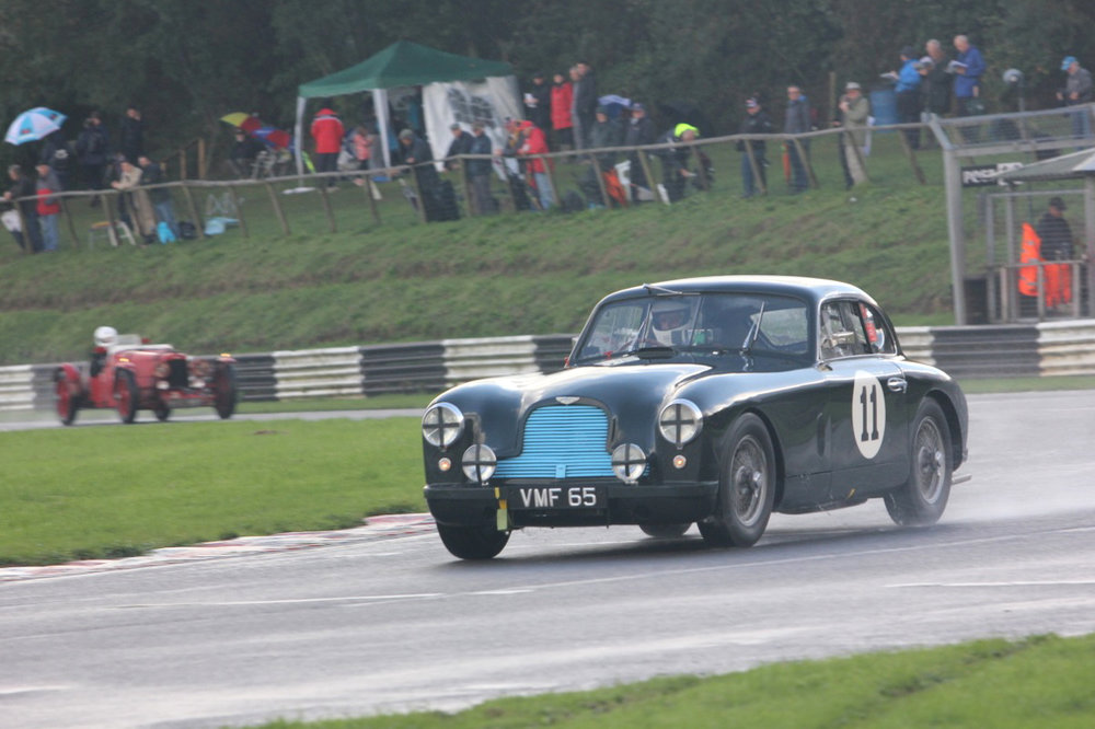 Another fantastic and historic Aston. The famous ex works DB2 , owned by Justin Kennedy, and driven by Tony Green. In the background Edward Bradley pursues in the Ulster.                                                                          Photo - Pat Arculus, Tripos Media