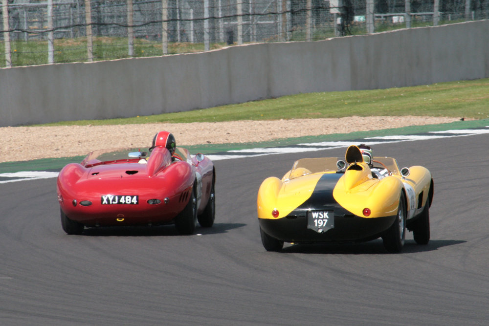 Recalling halcyon days!  The Ferrari gets up the inside of the Maserati at Woodcote but giving away a litre was usually behind at the end of the straights. Note the fuel filler flap which had popped up when James spun the Ferrari into Brooklands whilst in the lead. Photo John Turner