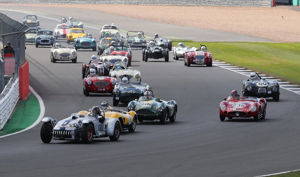 Off the start, Chris Keen snatched the lead in the Kurtis with James Cottingham in the Ferrari in close attendance. Steve Boultbee-Brooks has the Aston in 3rd whilst poleman, Guillermo Fierro Eleta takes the wide line and is about to lose another place to Martin Hunt in the HWM.  Photo - Richard Styles