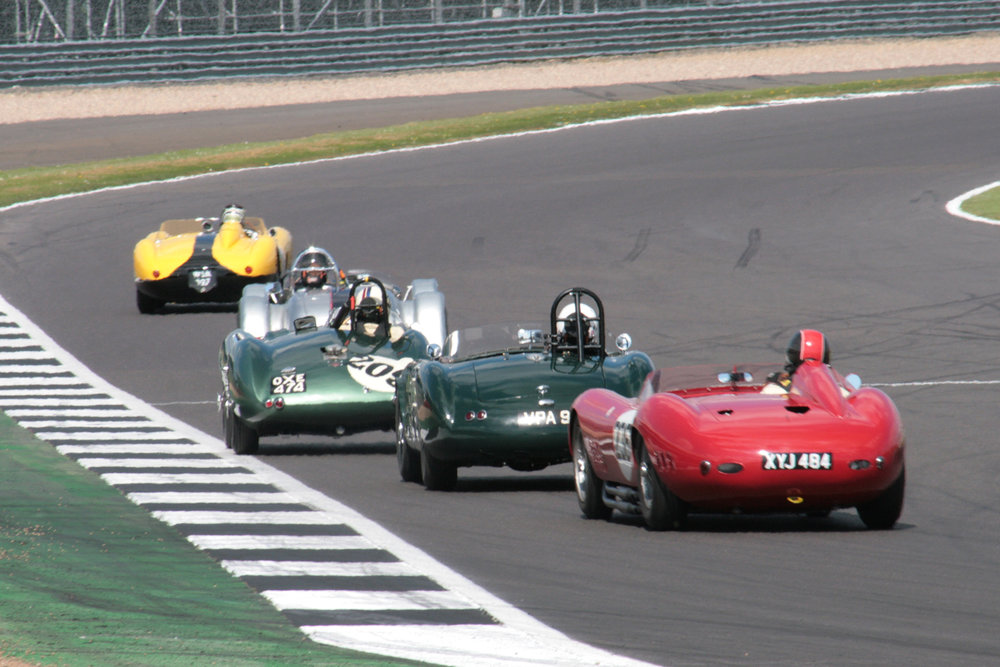 The leaders head into Woodcote for the first time - Ferrari, Kurtis, Aston, HWM, Maserati. Just out of shot is the Rudi Friedrichs Jaguar C type, soon to join them.                                                                                                                                             Photo - John Turner