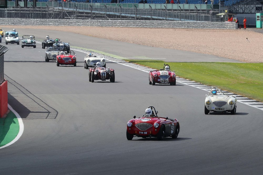 Behind the leaders ran 3 Austin Healeys led by Nick Matthews. Note that Jonathan Abecassis has recovered some ground in the LHD Austin Healey (20) but is being closely challenged by John Ure in the Frazer Nash Le Mans Replica. Behind is the second group of 3 Austin Healeys and Frazer Nash - see text - and indeed a third Frazer Nash can be seen with Martyn Corfield aboard, just ahead of Mark Hoble in the Turner and Stephen Bond in the Lister Bristol.                                                                                                                                                   Photo -  Richard Styles