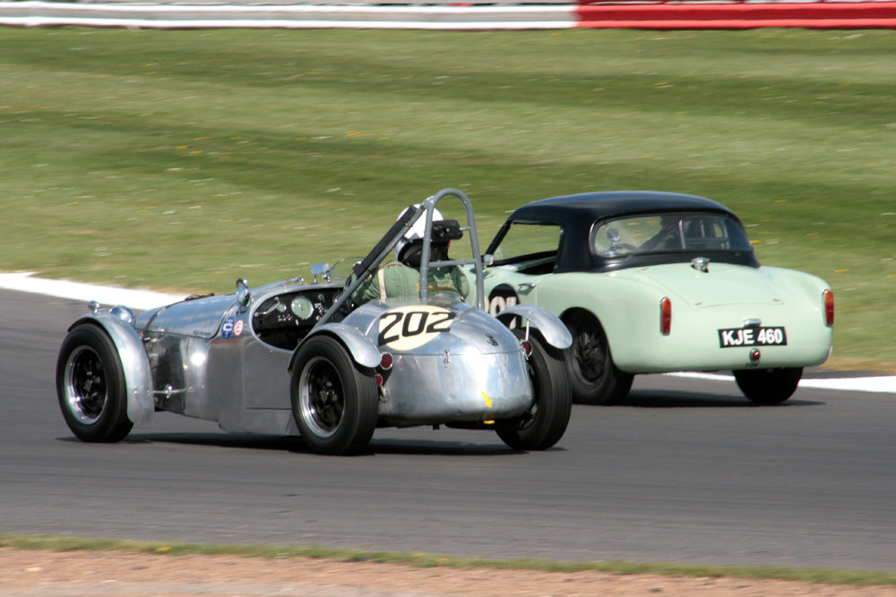 Nigel Batchelor kept his Cooper MG in touch with the Turner of James Bilderbeck for several of the early laps before James got into his stride      Photo - John Turner