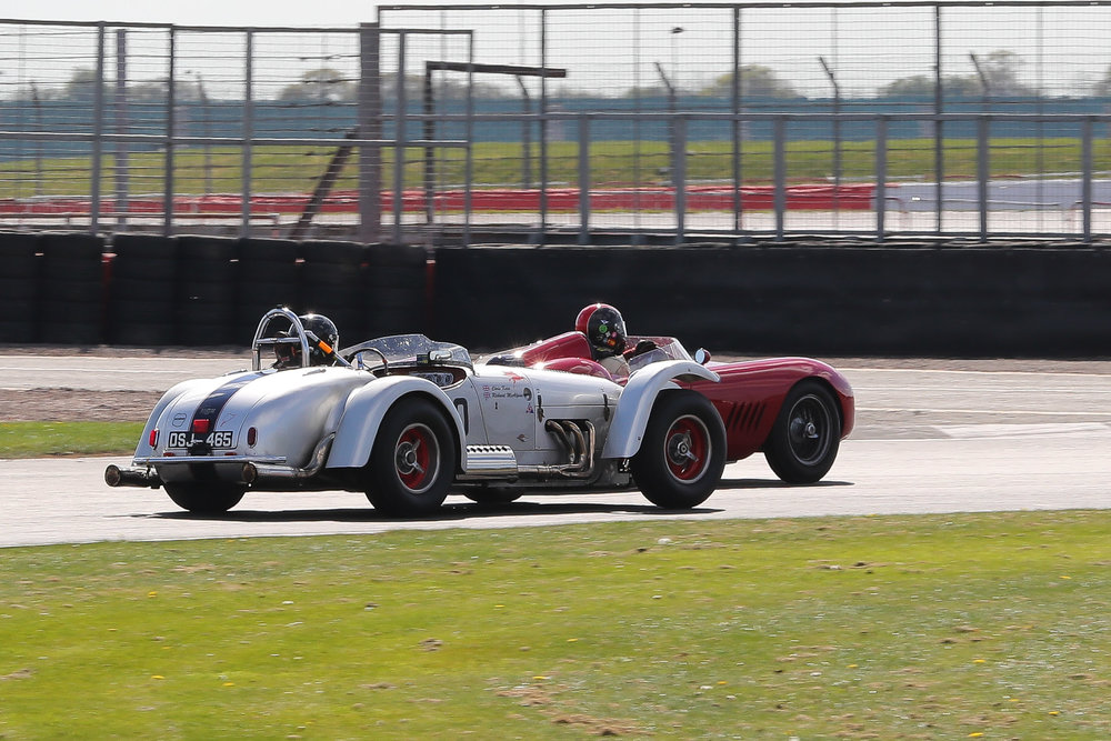 Chris Keen about to unlap himself from the Maserati which is yet to stop and running out of pit window do so. Older readers (which is probably most of us!) will recognise the significance of the DSJ in Kurtis registration.                                           Photo - Richard Styles