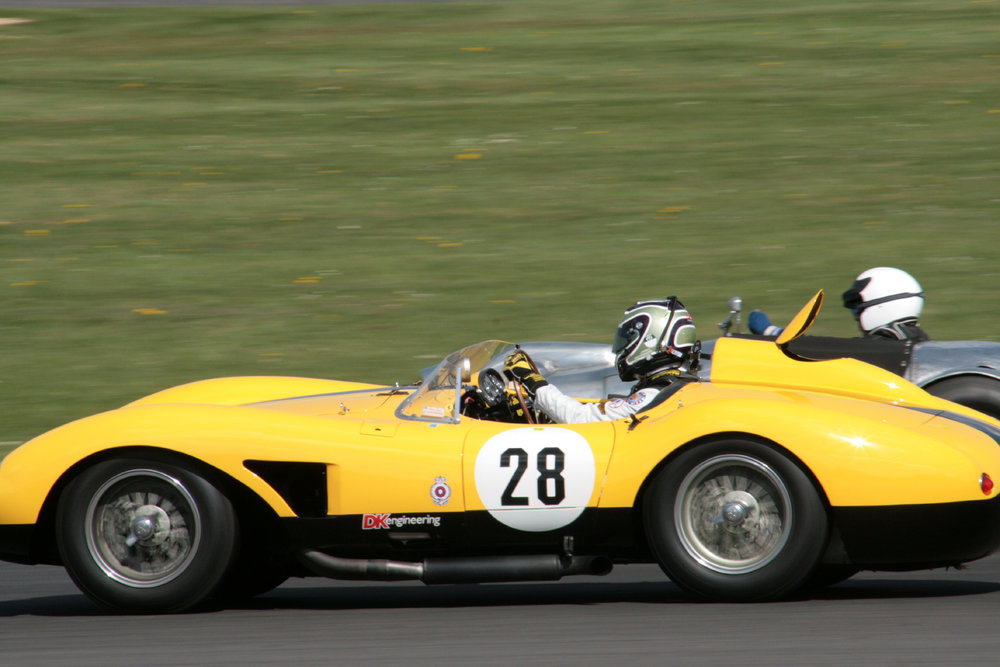 James Cottingham takes the Ferrari around the outsiide of Peter Campbell's Wingfield Bristol                   Photo - John Turner