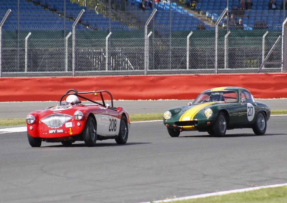 Roll displayed by both Paul Mortimer's Austin Healey and Mike Freeman's Lotus Elite as they charge out of Brooklands       Photo- Bob Bull, Tripos Media