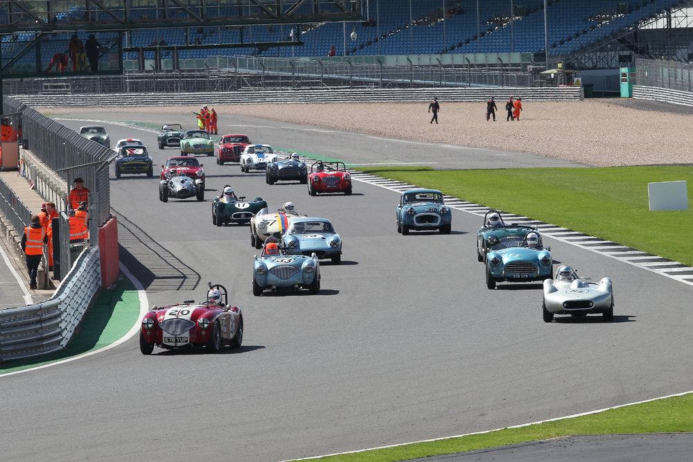 The grid rolls off on its green flag lap. The only car not in sight is Alan House's Morgan +4 tucked away to the left by the pit wall.   As usual a beautiful grid of cars but we could have done with a few more.  Photo - Mick Walker