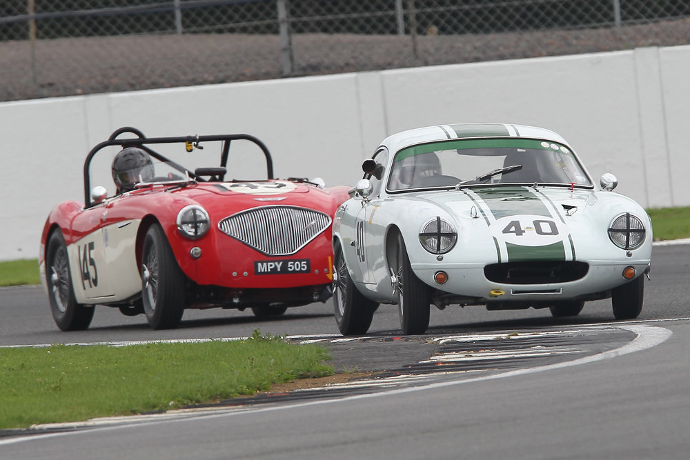 Barry Dye qualified 12th in his Lotus Elite but was unable to take the start due to clutch faiulure at the end of the practice session. Here he is followed by Paul Mortimer ,  also new to FISCAR with his Austin Healey 100.                                                                                                                                         Photo Mick Walker