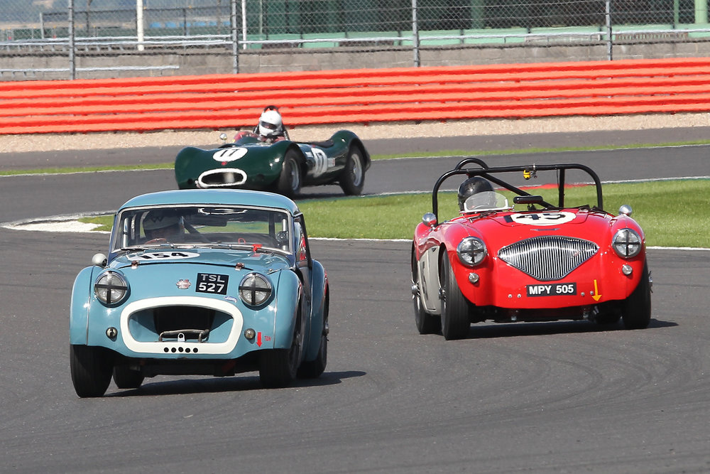 Paul Ziller made a good start getting his TR2 ahead of both Paul Mortimer in the Austin Healey (145) and Alex Quattlebaum in the LECo (11), although the Austin Healey's ultimate pace was 1.5 seconds a lap quicker than the TR which was to have its own drama, here, in Luffield a few laps later.    Photo - Mick Walker