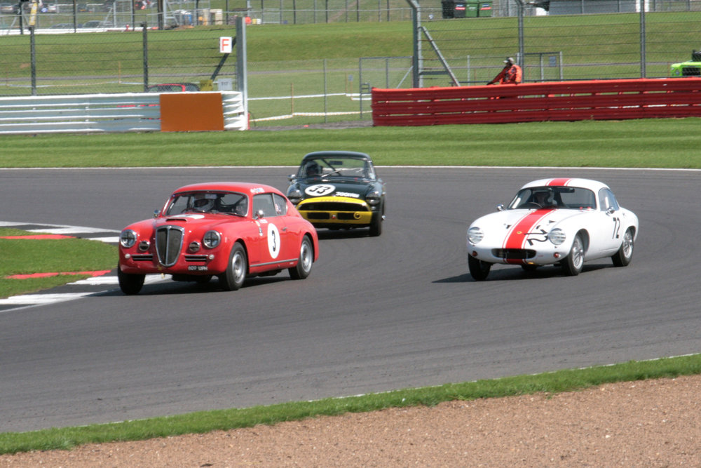 Further down the field a lovely eclectic mix of cars - Lancia Aurelia (Jason Kennedy),  Lotus Elite (John Waterson) & Sunbeam Alpine Le Mans (Keith Hampson).                                                                                                                                                      Photo - John Turner