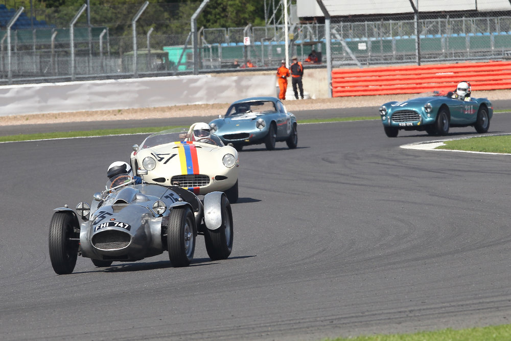 Lap 6 and the middle order is led here by Peter Campfield (Wingfield Special) chased by Nigel Winchester (AC Ace Special bodied), Robin Ellis (Lotus Elite) and David Cottingham (AC Ace). Only the Elite is not Bristol powered.                           Photo - Mick Walker