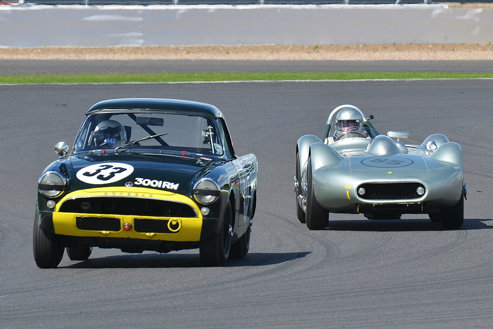 Keith Hampson's Sunbeam Alpine Le Mans about to be lapped by the leader, Stephen Bond in the Lister Bristol                Photo - Peter Olley, Tripos Media