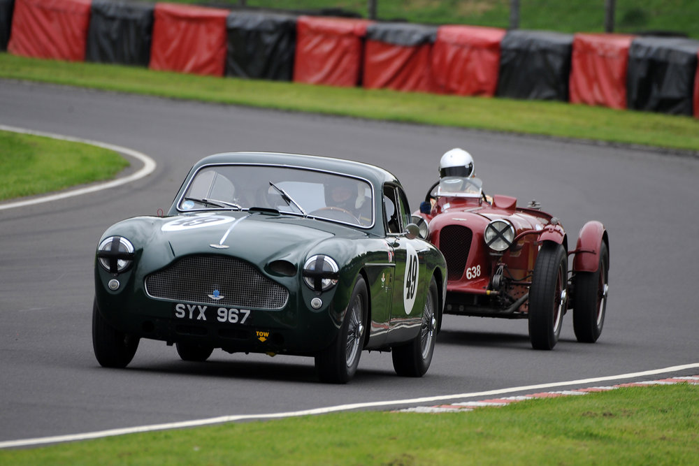 In the Jon Gross Memorial Trophy, the GT class winner was, very appropriately, Chris Woodgate, driving Jon's Ex Sebring Aston Martin DB MkIII which is still retained by the Gross family. Here Chris is seen ahead of the Aston Martin Brooklands driven by Mark Gillies who again won the Mort Goodall Cup for prewar Astons.       Photo - Jeff Bloxham