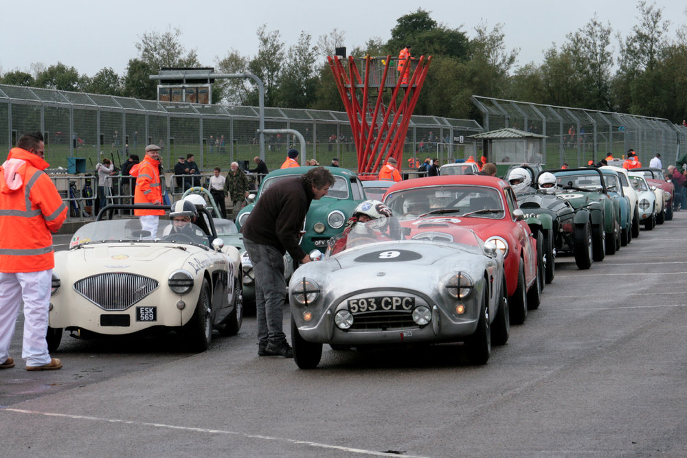 Two rows of Inter-Marque cars line up for what turned out to be another wet qualifying. On the front, Marc Mezey (Austin Healey 100/4) & Kevin Kivlochan Photo - John Turner