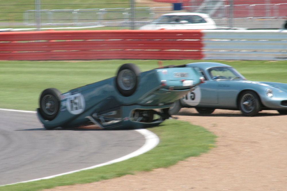 The car sliding towards the gravel trap with Robin Ellis endeavouring to keep clear                    Photo - John Turner