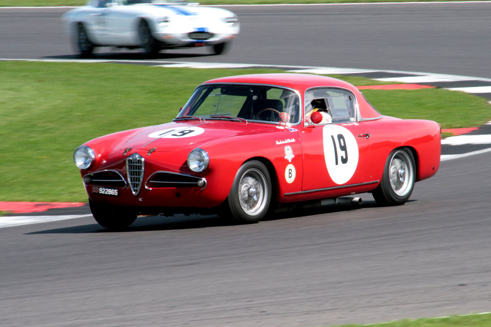 Matthew Holme in the stunning Alfa, presses on                                                               Photo - John Turner