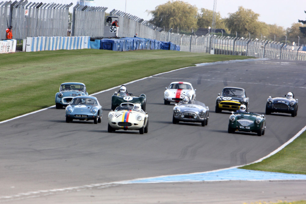 Nigel Winchester burst through from the second row to head the field into Redgate. Good starts also from Jim Campbell in the Austin Healey and Paul Ziller in the TR2 (far left)                                                                                     Photo - Pat Arculus, Tripos Media