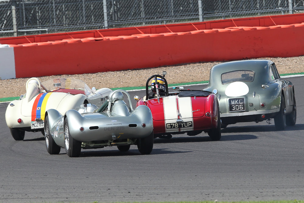 Stephen Bond presses Richard Woolmer as both try to negotiate back marker Mark Campbell in the glorious DB2 (MKC 306) and Nigel Winchester in the special bodied AC Ace (MCZ 65). Another superb photo by Mick Walker