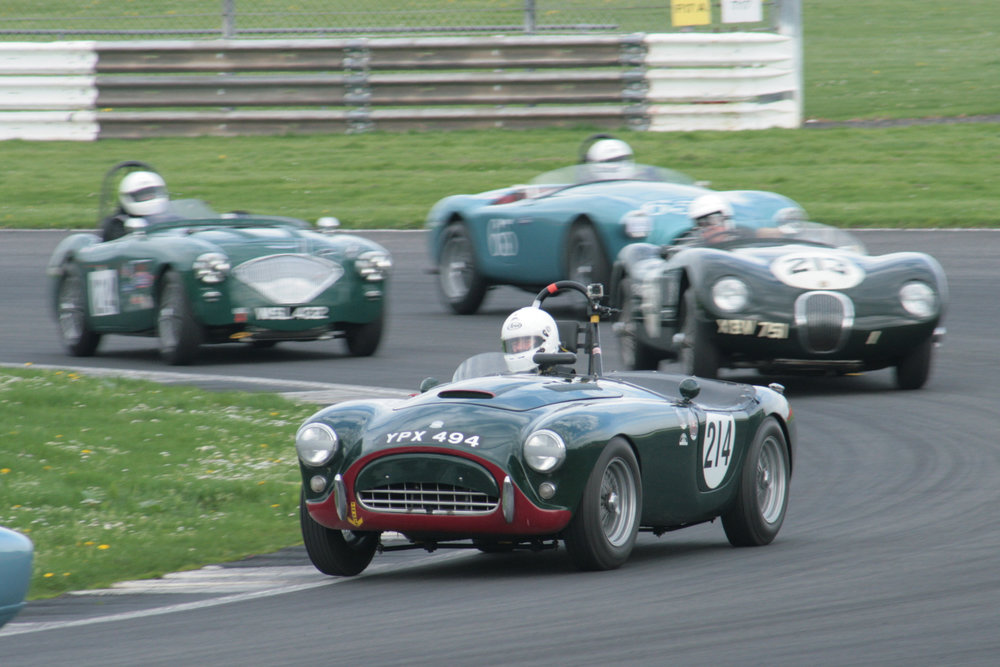 Tim Pearce drove his AC Ace superbly to finish 7th just behind the Lotus Elite of Brian Arculus. Here, David Brazell (Jaguar C Type) Jim Campbell (Austin Healey 100/4 and David Cottingham (AC Ace) give chase. Photo - John Turner