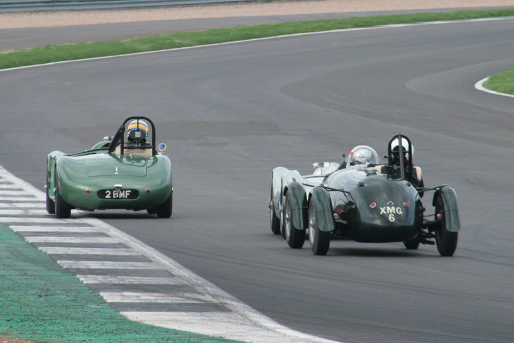 Stephen Bond (Lister Bristol), just visible  and Martyn Corfield (Frazer Nash LMR) hound Richard Woolmer in the HWM  Cadillac through Woodcote. This terrific scrap lasted for many laps                                                                                          Photo - John Turner