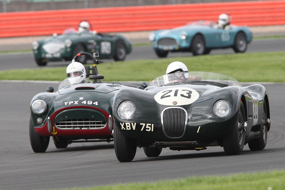 Tim Pearce (AC Ace) latches onto the tail of David Brazell's C-type Jaguar. In the background, Jim Campbell (Austin Healey 100/4) holds off David Cottingham's AC Ace. Between the two pairing out of sight and to the left is the Allard J2.       Photo - Mick Walker